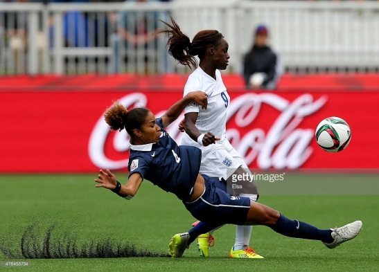 Source: Getty Images - England's Eniola Aluko and France's Laura Georges battle for the ball in the 2015 Women's World Cup.